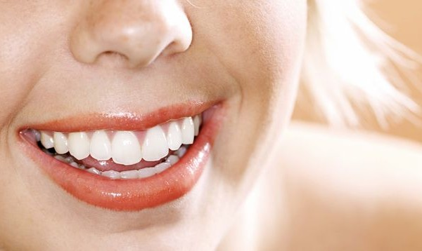 16. How do you get white teeth naturally