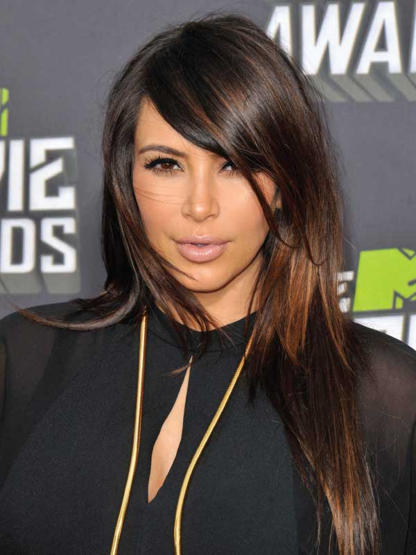 Kim Kardashian with a Sleek Side Part Hairstyle