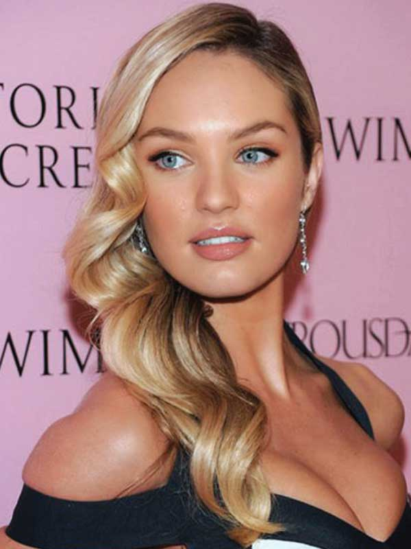 Candice Swanepoel with a Glamorous Side Part Hairstyle